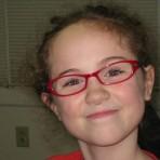 Milena, specs and smile